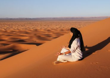 Meditating on the sand dunes. Photo by Lalo Fuentes
